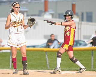 Walsch's Taylor Koenig (6) plays fi rst base as Mooney's Macy Ucchino (14) prepares for a run to second