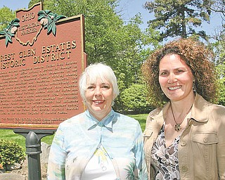 Lynn Kirkwood, left, and Susan Sweeney, vice president and president, respectively, of the Forest Glen Homeowners' Association, stand next to the marker designating their neighborhood a historic district. Residents of both the Forest Glen and the Newport Glen historic areas expressed worries to Boardman trustees last week about increased crime. The township has a plan to address it and educate all residents about how to protect themselves.