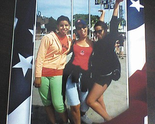 Santa Cruz of Boardman is hamming it up with her daughters, Alexia M. Santiago and Jaclyn C. Williams, at Cedar Point.