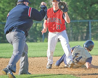 The Vindicator|Geoffrey Hauschild.Struthers' Anthony Lariccia (11) shows his proff after outting Lowellville's Ryan Whinery (14) during the fourth inning of a game at Cene Field on Thursday afternoon.