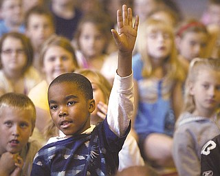 Jovan Gearo, a Lloyd Elementary second-grader, asks a question about the summer reading program run by the Public Library of Youngstown and Mahoning County.