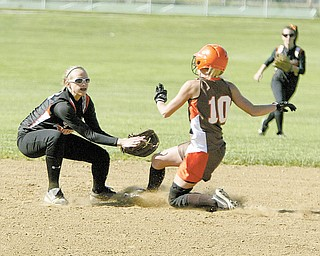 Springfield's Ashley Davis gets East Palestine's Emily Stewart (10) out on a steal attempt of second base during their Division III tournament softball game Monday in East Palestine. Stewart had two hits for the Bulldogs, who shut out the Tigers, 3-0, and advanced to a sectional final today against Cardinal Mooney.