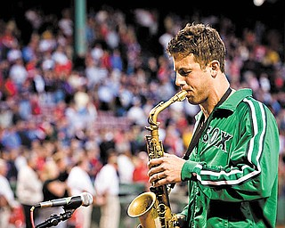 "Liberty High graduate Jerry DePizzo of the rock band O.A.R. plays the national anthem before a Boston Red Sox game in 2008. FOX Sports is using O.A.R.'s ""This Town"" for its Major League Baseball promotions nationwide."