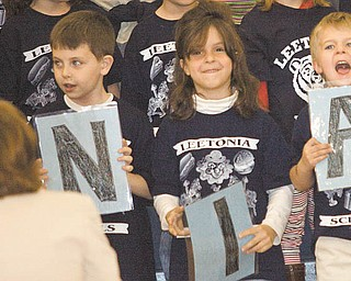 Leetonia kindergarten pupils, from left, Michael Miller, Cameron Firtik, Brooke Frye and Conner Alflen, take part in an assembly honoring Leetonia High School for its being named one of Ohio's top schools.
