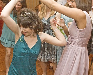 LISA-ANN ISHIHARA   THE VINDICATOR...Paige Goodman and Lauren Stevens, both of Liberty High School, dance at the annual tri county special needs prom, held at Anthone's.