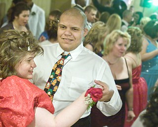 LISA-ANN ISHIHARA   THE VINDICATOR...L-R Jordan Bertolette of Columbiana High and Romann Williams of Fitch dance at the annual tri county special needs prom, held at Anthone's.