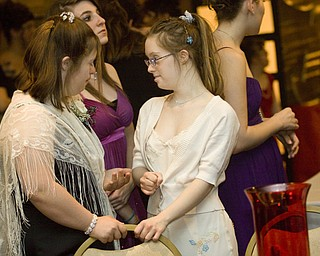 LISA-ANN ISHIHARA | THE VINDICATOR...Erica Double, 16, Boardman and Lizie Luman, 18, Boardman, chat at the annual tri county special needs prom, held at Anthone's.
