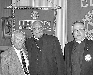 The Paul Harris Fellow award was presented to Bishop George V. Murry during the April 28 meeting of Youngstown Rotary Club. The award was presented to Bishop Murry in appreciation of his work with Catholic Charities in feeding the poor in the community and in poor countries and for his assistance in building friendly relations among the people of the world. Sharing the moment with Bishop Murry, center, are from left, Dr. Bo Edwards, Rotarian, and Monsignor Robert Sifrin, Rotarian and former club president.