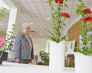 LISA-ANN ISHIHARA | THE VINDICATOR..Sister Mary Cunningham of Youngstown looks at the floral arrangements at the Garden Forum Spring Flower show inside Fellow Riverside Gardens.