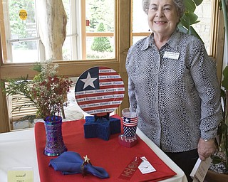 LISA-ANN ISHIHARA | THE VINDICATOR..Rose Marie Ruth poses with her submission for Stars & Stripes, receiving Second Premium in the Garden Forum Spring Flower show at Fellows Riverside Gardens.