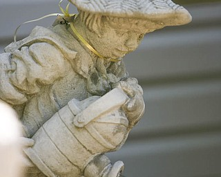 ROBERT K. YOSAY | THE VINDICATOR..Not just ornaments - but a dutch boy water fountain -  at Farmer Dave's Gift and Garden Shoppe   in  North Lima -- 30-
