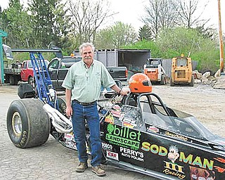Boardman drag racer Tony Billet poses with his car, Sod Man III, which was destroyed recently in a fiery crash.