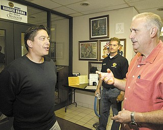 Keith Fingerhut, left, a transfer employee to GM Lordstown from GM's closed Wilmington, Del., facility, talks with Jim Graham, president of United Auto Workers of America Local 1112, during a break in an orientation session. Fingerhut said he is excited about being at Lordstown and building the Chevrolet Cruze.