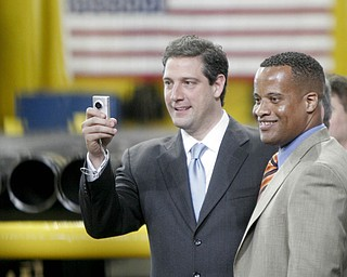 William D Lewis| The Vindicator  Tim Ryan snaps a photo while Jay Williams looks on during 5-1810 visit tio VM Star Steel by Preside3nt Obama.