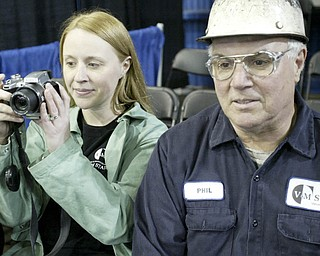 William D Lewis| The Vindicator Melissa Takasand her father Phil Willich,of Poland and  both employees of V& M Star Stelel take in the visit of President Obama  5-18-10.