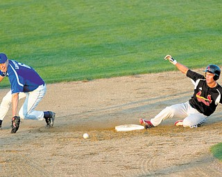Nick Benson (7) safely reaches second base after Hubbard's Mike Lopuchorsky(6) bobbles the ball during the second inning of a Division II District Semi Finals Game at Cene Field on Wednesday evening.