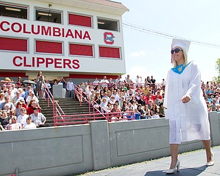 Geoffrey Hauschild|The Vindicator.Graduate, Chelsea Rae Macklin, receives her diplomia and crosses the stage during Columbiana High School's 2010 Commencement Ceremony at Firestone Park on Sunday afternoon.