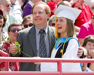 Geoffrey Hauschild|The Vindicator.Jay Lloyd Williamson receives a flower from her daughter, Jennifer Lynn Williamson, one of two class valedictorians, during Columbiana High School's 2010 Commencement Ceremony at Firestone Park on Sunday afternoon.
