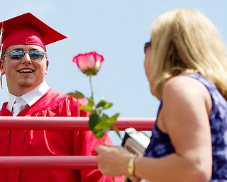 Geoffrey Hauschild|The Vindicator.Graduate, Michael McMaster, presents his mother, Carrie McMaster, during Columbiana High School's 2010 Commencement Ceremony at Firestone Park on Sunday afternoon.