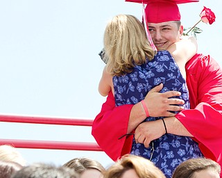 Geoffrey Hauschild|The Vindicator.Graduate, Michael McMaster, gets a hug after presenting his mother, Carrie McMaster, with a flower during Columbiana High School's 2010 Commencement Ceremony at Firestone Park on Sunday afternoon.