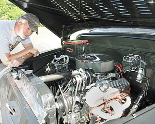 Dick Bray of Brookfield, co-founder of the Campfire Street Rodders, checks out his 1956 Chevrolet pickup. It and many others will be on display at this weekend's car show at Church Hill Park in Liberty.