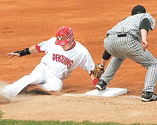 Youngstown State's Jacke Healy, left, steals third base during the first inning of a Horizon League game against Wisconsin-Milwaukee on April 23 at Eastwood Field. Milwaukee's Doug Dekoning is late with the tag. The Penguins play UIC in the Horizon League tournament on Wednesday at 4 p.m.