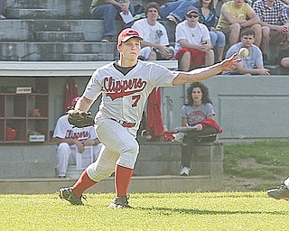 Columbiana pitcher Hank Schlueter fires a throw to fi rst base after fielding a bunt attempt during a recent game. The Clippers will play Buckeye Central in a Division IV regional baseball game on Thursday.