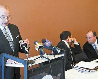 John B. Reardon, left, former Mahoning County treasurer, speaks to reporters at a news conference at the Covelli Centre concerning the county's purchase of Oakhill Renaissance Place as county Auditor Michael V. Sciortino, center, and Commissioner John A. McNally IV confer. Reardon, Sciortino and McNally said Tuesday that mounting Oakhill-related bills have substantiated their objections to the purchase.