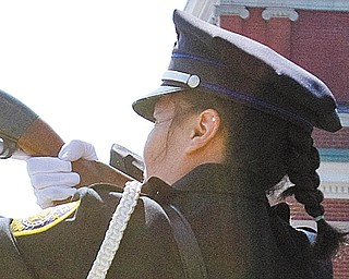 Sonia Wilson fires a salute, with other members of the YPD, in honor of past fallen police officers during the Annual Fallen Officers Memorial.