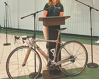 Erin Quinlan of Carbon Racing discusses the 2010 Tour of the Valley bicycle race during a press conference Thursday in downtown Youngstown. The event is scheduled July 9-11.