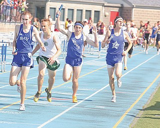 Poland senior Sean Murphy, third from left, and Lakeview senior Albert Brannan, right, cross the fi nish line Thursday afternoon in the 4x800-meter relay at the Division II regional meet in Ravenna. Poland was third and Lakeview fourth behind Bay Village Bay and Elyria Catholic.