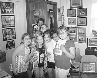 Third-graders from Roosevelt Elementary School in Hubbard pause during their tour of the Hubbard Historical Society's McBride House on Hager Street. Members of the society recently gave 150 students the tour. Group tours of McBride House are regularly scheduled for the second Sunday of the month, but also can be scheduled at other times. To set up a tour, call Cecilia Cooper at 330-534-4247.