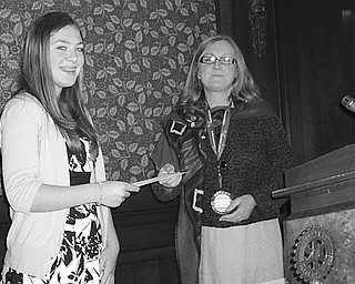 Julia Miglets, left, who won the Rotary Club of Youngstown's spelling bee recently, received a $100 savings bond from Mary Womble, Rotary president, at the club's May 12 meeting.