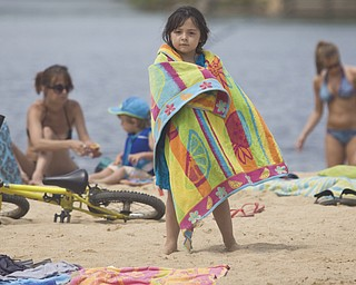 LISA-ANN ISHIHARA | THE VINDICATOR..Lilly Fultz (5) of Parma wraps up in a towel after swimming during day one of Jonesfest at Nelson Ledges Quarry Park.