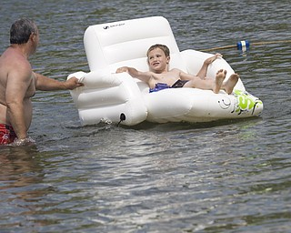 LISA-ANN ISHIHARA | THE VINDICATOR..Richard Wilkinson of Wingham and his grandson Jeffrey Byrd (7) of .Willoughby Hills hang out in the lake during day one of Jonesfest at Nelson Ledges Quarry Park.