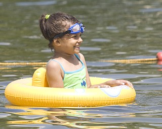 LISA-ANN ISHIHARA | THE VINDICATOR..Lydia Graves (5) of Akron enjoys the sun and cool water in her floatee during day one of Jonesfest at Nelson Ledges Quarry Park.