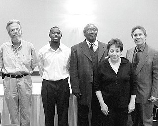 Receiving awards for their work with Youngstown Area Goodwill Industries at a banquet May 13 were, from left, John Ogarek, graduate of the year; Harlan Jones, supervisor of the year; Jerry Scott, employee of the year; Kathleen Dutko, graduate of the year; and Toby Mirto, president of the Goodwill board of trustees, who made the presentations.
