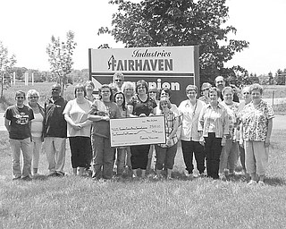 Volunteer staff and employees from Fairhaven Industries sponsored a rummage sale recently at the Champion Fairhaven Workshop to raise funds for the new location of the Animal Welfare League of Trumbull County on Educational Highway in Warren. The event raised $2,500. Volunteers for the sale are, from left, Michelle Swonger, Sue Shrader, Richard Turner, Janis Metzendorf, Karen Marberger, Dave Sekarek, Tracy Blakeley, Amanda Cartright, Debbie Agostinelli (TC Animal Welfare), JoAnne Pecorelli, Dennise Lindsey, Holly Yannucci, Angie Terbovich, Leah Yannucci, Cindy Bailey, Robin Hefner, Mary Miller, Rick Mistovich, Cathy Jones, Pat Larkins and Bridgett Ursu