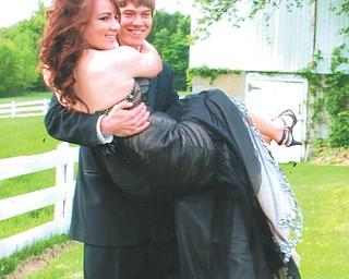 Aaron Hartsough, a Canfield High School senior, and Rachael Morris, a junior.
