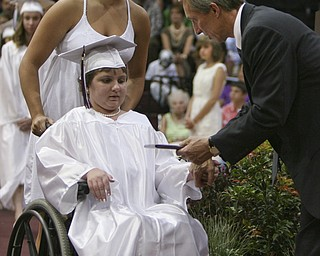 ROBERT K. YOSAY | THE VINDICATOR..Abbey  Przicina  recieves her diploma from  Mark Fulks - president of the school board . helping her is  Miah Gasparek  at Boardman High Schools Graduation 2010 held at the school -30