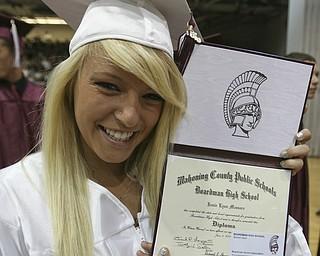 ROBERT K. YOSAY | THE VINDICATOR..Proud of her accomplishment Jamie Lynn Massaro displays her diploma at Boardman High Schools Graduation 2010 held at the school -30