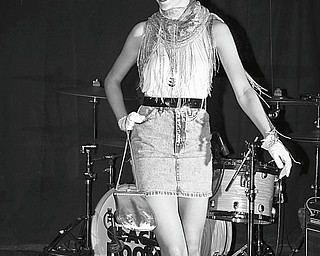 Maggie Wagner models an outfit created by Emily Plaskett, designer, from items donated to FrockOn by the Village Discount Outlet on Mahoning Avenue, Youngstown. Wagner walked the runway during a Going Green party May 29 at the Cedars in Youngstown. The party promoted recession chic thrift shopping during tough economic times.
