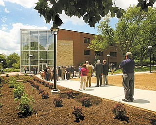 Offi cials and community members celebrate the completion of East Campus Gateway. The project, along University Plaza on the east side of campus, includes a glassed entryway to the Tod Hall administration building, major renovations to Coffelt Hall, a visitors parking lot, a new marquee sign outside Bliss Hall and new lighting, landscaping, banners and a traffic circle.