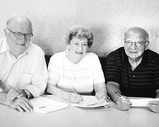 South High School Alumni Association prepares for its 36th annual alumni reunion on June 25 at the Saxon Club in Youngstown. Those involved in the planning include, from left, Chuck Whitman, alumni association president, class of 1946; Elberta Bullman Scott, treasurer, class of 1939; and John Athanasen, second vice president, class of 1959.