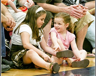 ROBERT K. YOSAY | THE VINDICATOR..Friendly banter  as Samantha Dubos Macenzee Gaal (ok) 4, and 8 and both of Lowellville respectively as they girl talk.. ( at Lowellville High School gym - the glass of 2010 - graduated Sunday afternoon-30