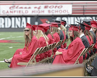"LESLIE CUSANO | THE VINDICATOR.Canfield graduates listen to the Canfield High School choir sing ""A Closing Prayer"" by Don Besig."