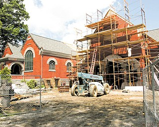 The blue vehicle is parked in front of the planned new entry at Lisbon's Lepper Public Library. The door and the overall expansion will match the original design to make the library look like an English country church.