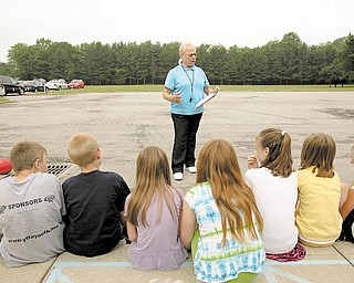 Dolores Saunders, 70, of Canfield, retired Friday after 41 years with the Canfield School District. Saunders, a physical-education teacher, goes over the rules of kickball during a session outside with a class at Hilltop Elementary.