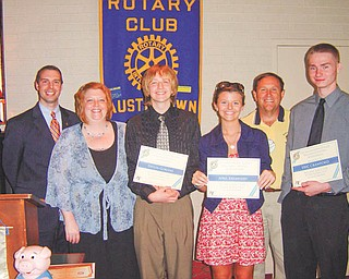 Austintown Rotary Club awarded William Courtney Memorial Scholarships to three Interact Club students at the June 7 meeting. Among those involved in the awards ceremony are above, from left, Brian Laraway, club president; Shelli Trasp and her son Devlin Geroski, who will attend Hiram University; April Krempasky, who will study event and hospitality management in Florida; Gary Reel, who presented the awards; and Eric Crawford, who collected 1,800 items for Interact Club's food drive and will attend Ohio State University.
