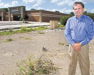 Bill Kutlick, a broker for Kutlick Realty, stands in a vacant lot on which an Arby's restaurant formerly stood on U.S. Route 224 in Boardman. The property will be home to a new 4,500-squarefoot Verizon Wireless store. Boardman's retail corridor is undergoing several redevelopment projects as the impact of the economic recession begins to soften.
